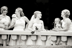Shot of a bride and her bridesmaids on a balcony at Foothills Golf Club