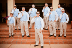 Shot of a groom and his groomsmen at the front entrance of Foothills Golf Club